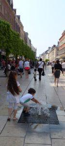 children playing, fountain, water,